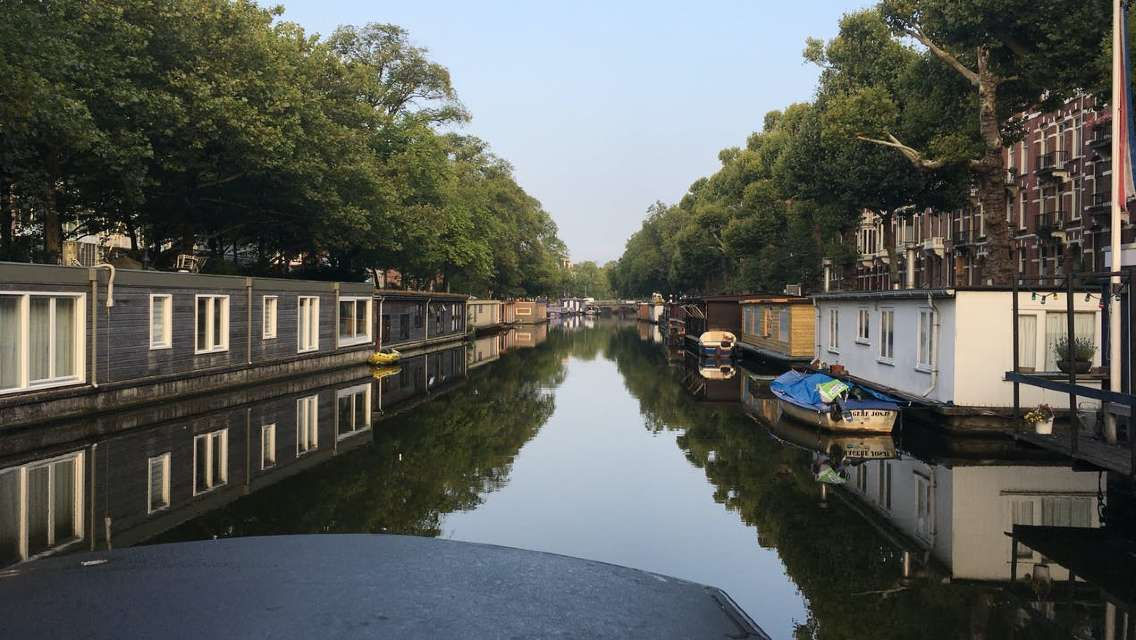 Early morning Amsterdam canals boat tour