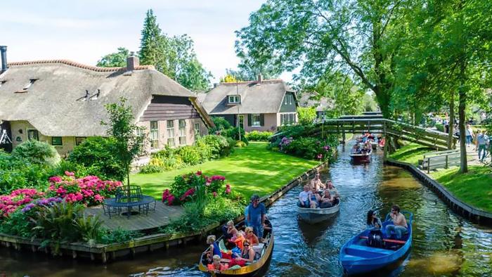 荷蘭阿姆斯特丹桑斯安斯風車村+阿夫魯戴克攔海大壩+羊角村一日遊(可選包車、散拼、多種路線)