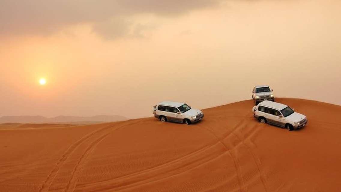 PRIVATE Red Dune Desert Safari, BBQ Dinner, Camel Ride & Falcon Photo